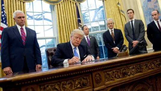 Trump signs abortion executive action in a room of white men.jpeg